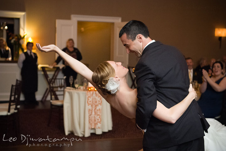 Bride and groom doing the dip during first dance. The Tidewater Inn Wedding, Easton Maryland, reception photo coverage of Kelsey and Jonnie by wedding photographers of Leo Dj Photography.