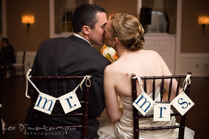 Bride and groom kissed at their sweetheart table. The Tidewater Inn Wedding, Easton Maryland, reception photo coverage of Kelsey and Jonnie by wedding photographers of Leo Dj Photography.