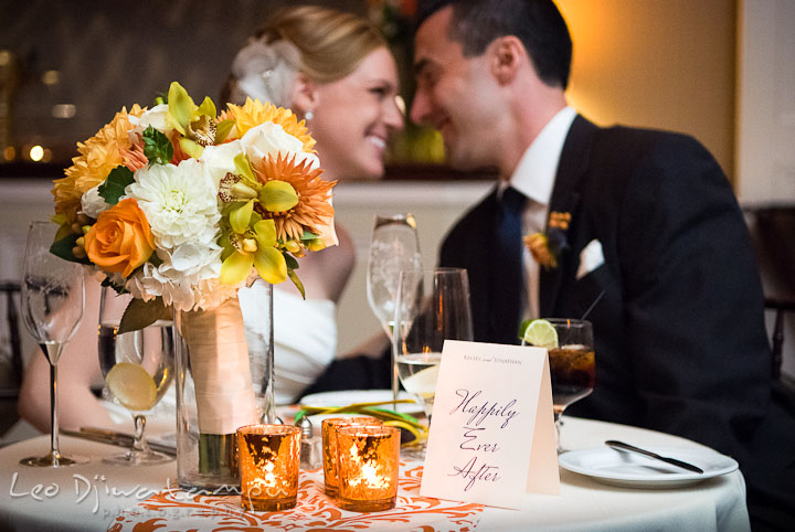 Bride groom smiling at sweetheart table. The Tidewater Inn Wedding, Easton Maryland, reception photo coverage of Kelsey and Jonnie by wedding photographers of Leo Dj Photography.