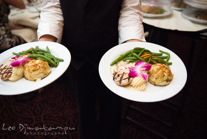 Dinner plate served with crab cake and grilled chicken. The Tidewater Inn Wedding, Easton Maryland, reception photo coverage of Kelsey and Jonnie by wedding photographers of Leo Dj Photography.