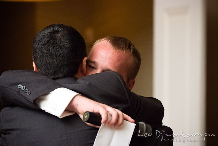 Best man hugged groom after speech. The Tidewater Inn Wedding, Easton Maryland, reception photo coverage of Kelsey and Jonnie by wedding photographers of Leo Dj Photography.