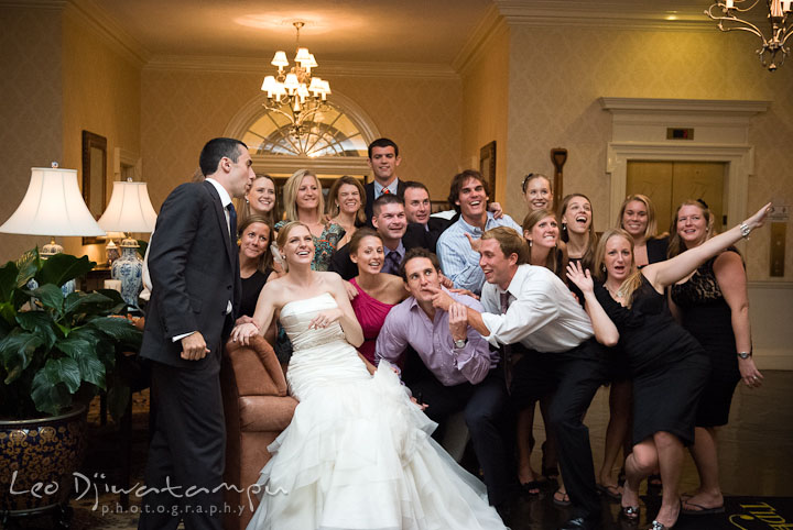 Groups shot with goofy gestures and funny expressions. The Tidewater Inn Wedding, Easton Maryland, reception photo coverage of Kelsey and Jonnie by wedding photographers of Leo Dj Photography.