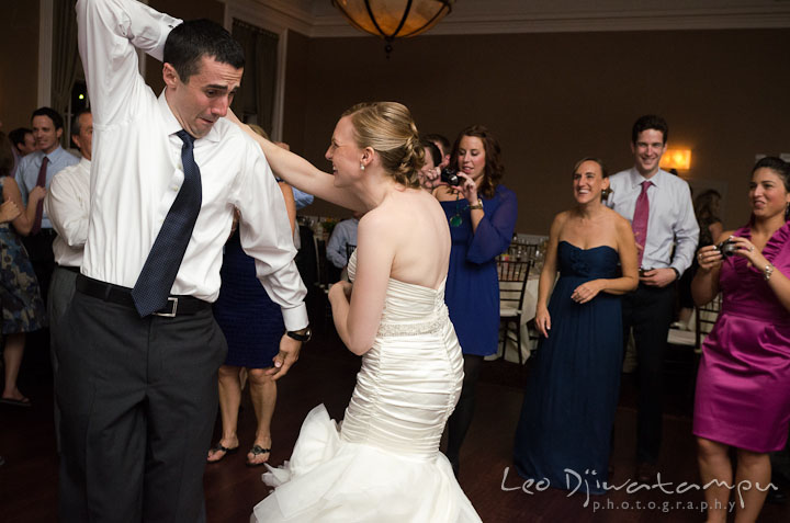Groom trying to twirl bride. The Tidewater Inn Wedding, Easton Maryland, reception photo coverage of Kelsey and Jonnie by wedding photographers of Leo Dj Photography.