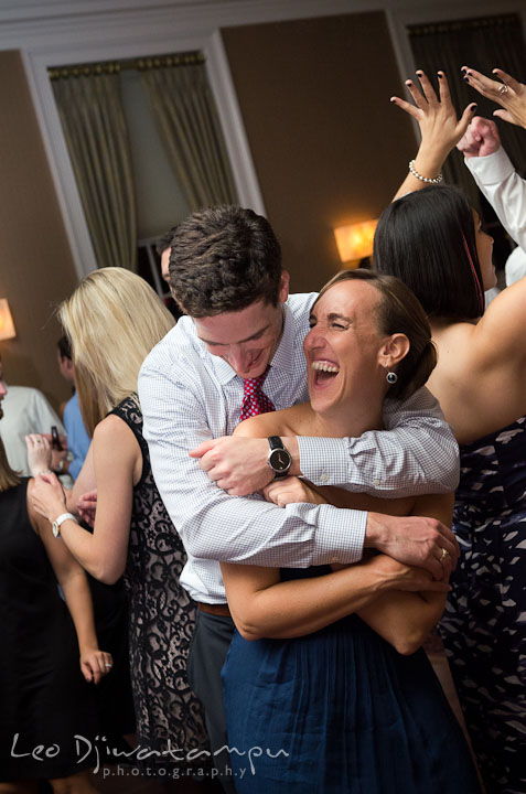Maid of honor and her fiancé dancing and laughing. The Tidewater Inn Wedding, Easton Maryland, reception photo coverage of Kelsey and Jonnie by wedding photographers of Leo Dj Photography.