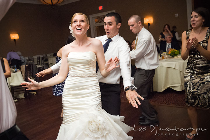 Bride and groom having fun dancing. The Tidewater Inn Wedding, Easton Maryland, reception photo coverage of Kelsey and Jonnie by wedding photographers of Leo Dj Photography.