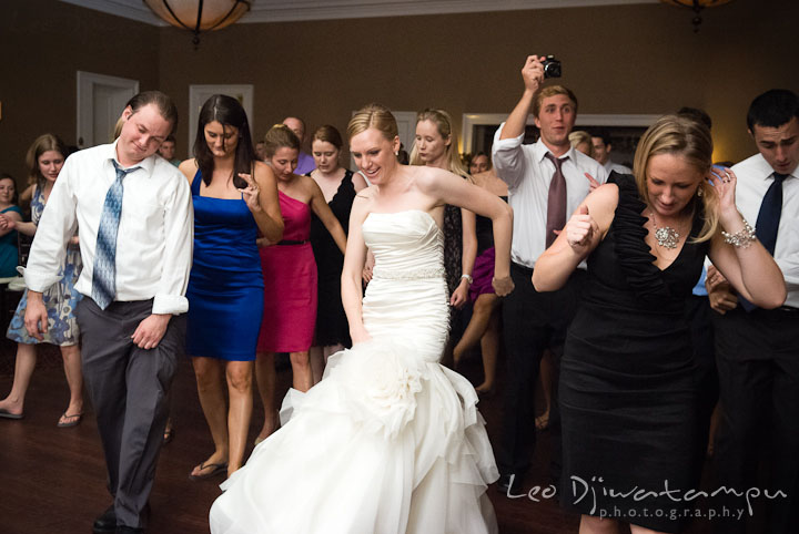 Bride, groom and guests dancing to Cupid Shuffle. The Tidewater Inn Wedding, Easton Maryland, reception photo coverage of Kelsey and Jonnie by wedding photographers of Leo Dj Photography.