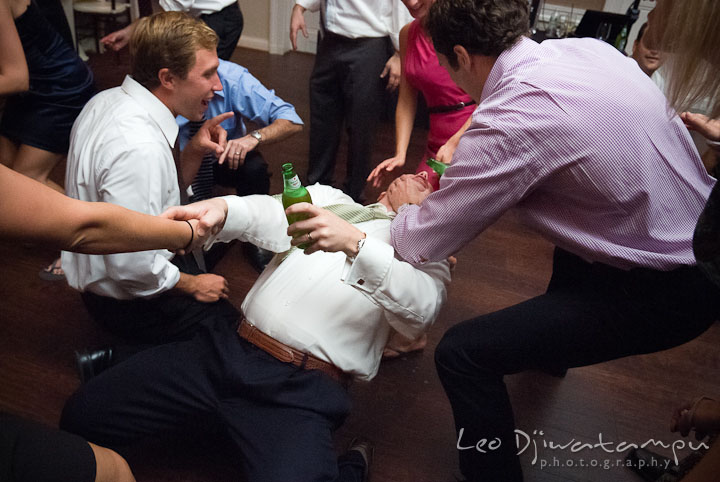 Guest pouring drink to another guest's mouth. The Tidewater Inn Wedding, Easton Maryland, reception photo coverage of Kelsey and Jonnie by wedding photographers of Leo Dj Photography.