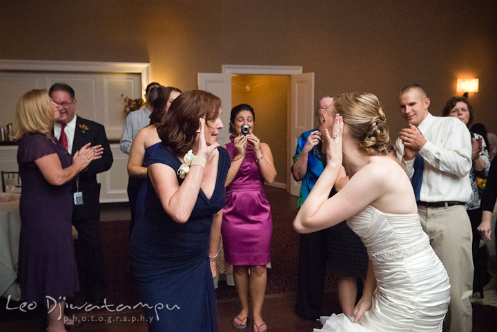 Bride and mother singing along and dancing. The Tidewater Inn Wedding, Easton Maryland, reception photo coverage of Kelsey and Jonnie by wedding photographers of Leo Dj Photography.