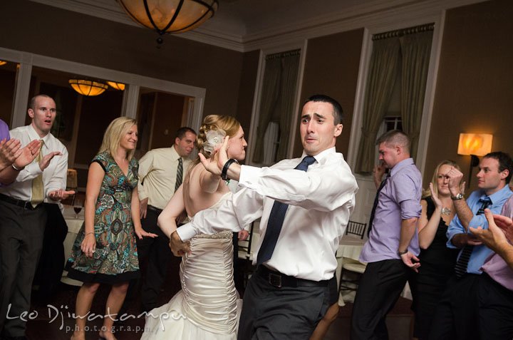 Bride and groom dancing to favorite song. The Tidewater Inn Wedding, Easton Maryland, reception photo coverage of Kelsey and Jonnie by wedding photographers of Leo Dj Photography.