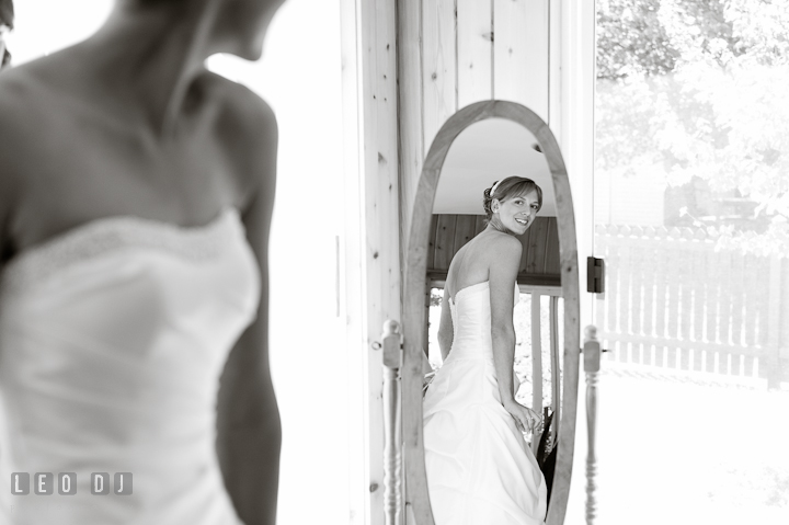 Bride checking out her dress on the mirror. Riverhouse Pavilion wedding photos at Easton, Eastern Shore, Maryland by photographers of Leo Dj Photography. http://leodjphoto.com
