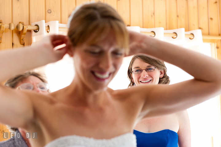Bride fixing her veil, helped by sister and Mother. Riverhouse Pavilion wedding photos at Easton, Eastern Shore, Maryland by photographers of Leo Dj Photography. http://leodjphoto.com