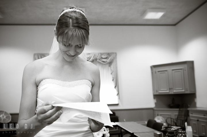 Bride reading letter from the Groom. St. Mark United Methodist Church wedding photos at Easton, Eastern Shore, Maryland by photographers of Leo Dj Photography. http://leodjphoto.com