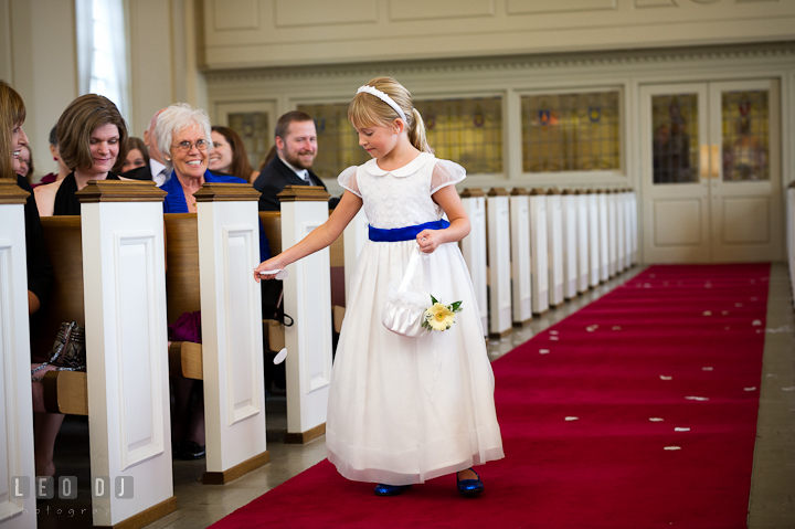 Flower girl spread flower petals while observed by smiling guests. St. Mark United Methodist Church wedding photos at Easton, Eastern Shore, Maryland by photographers of Leo Dj Photography. http://leodjphoto.com