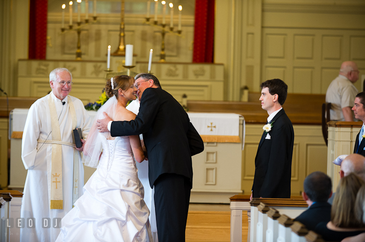 Father kissed bride as he gave her daughter away. St. Mark United Methodist Church wedding photos at Easton, Eastern Shore, Maryland by photographers of Leo Dj Photography. http://leodjphoto.com