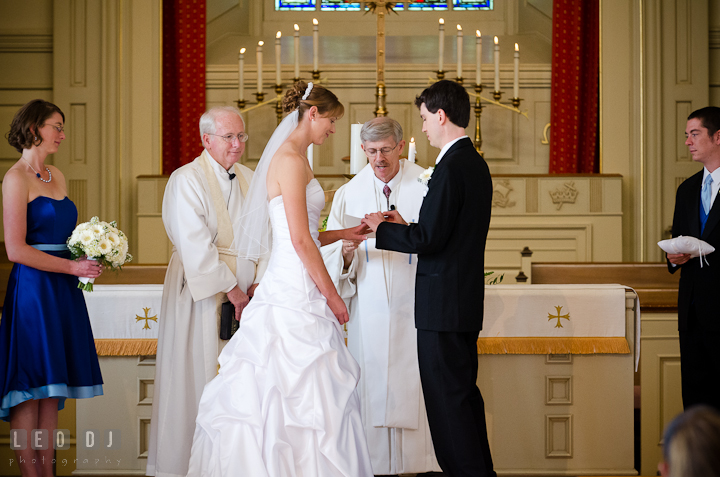 Exchanging of rings for the Bride and Groom. St. Mark United Methodist Church wedding photos at Easton, Eastern Shore, Maryland by photographers of Leo Dj Photography. http://leodjphoto.com