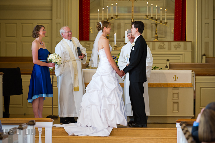 Bride and Groom holding hands and looking at each other. St. Mark United Methodist Church wedding photos at Easton, Eastern Shore, Maryland by photographers of Leo Dj Photography. http://leodjphoto.com