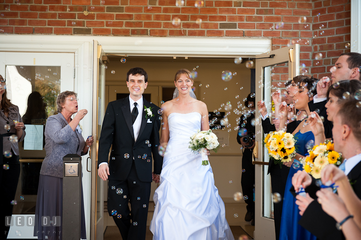 Bride and Groom exited the church and greeted with bubbles. St. Mark United Methodist Church wedding photos at Easton, Eastern Shore, Maryland by photographers of Leo Dj Photography. http://leodjphoto.com