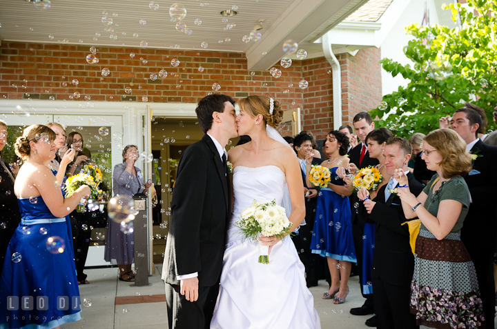 Bride and Groom kissing while guest are blowing bubbles. St. Mark United Methodist Church wedding photos at Easton, Eastern Shore, Maryland by photographers of Leo Dj Photography. http://leodjphoto.com