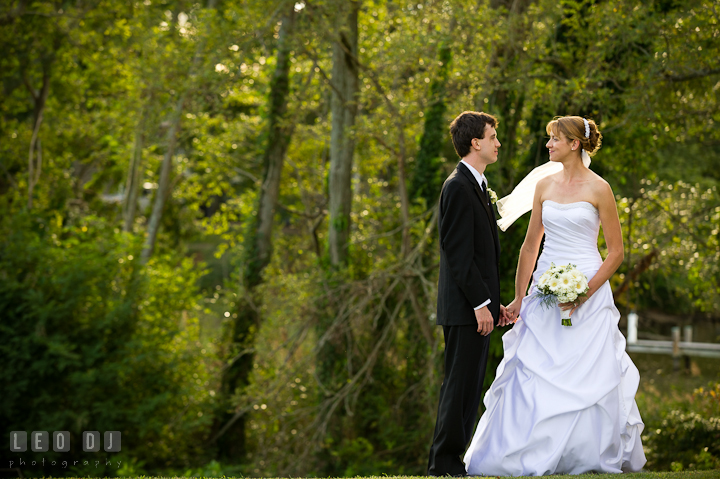 Bride and Groom holding hands and looking at each other. Riverhouse Pavilion wedding photos at Easton, Eastern Shore, Maryland by photographers of Leo Dj Photography. http://leodjphoto.com