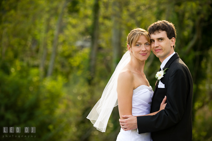 Bride and Groom posing for the camera. Riverhouse Pavilion wedding photos at Easton, Eastern Shore, Maryland by photographers of Leo Dj Photography. http://leodjphoto.com