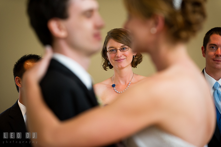 Maid of Honor and Bride's sister looking at the Bride and Groom's first dance. Riverhouse Pavilion wedding photos at Easton, Eastern Shore, Maryland by photographers of Leo Dj Photography. http://leodjphoto.com