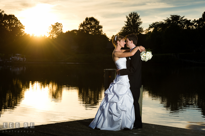 Bride and Groom at the pier during sunset. Riverhouse Pavilion wedding photos at Easton, Eastern Shore, Maryland by photographers of Leo Dj Photography. http://leodjphoto.com