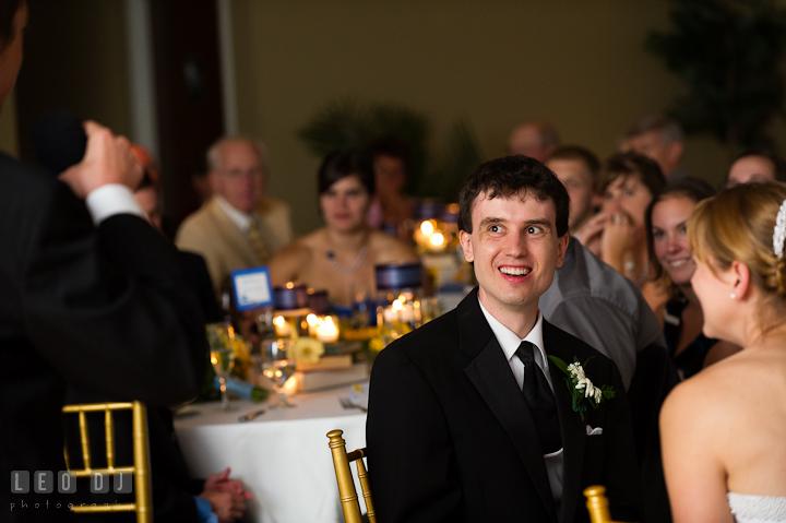 Groom laughing listening to Best Man's speech. Riverhouse Pavilion wedding photos at Easton, Eastern Shore, Maryland by photographers of Leo Dj Photography. http://leodjphoto.com