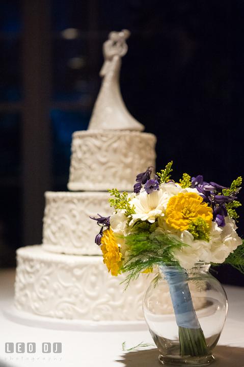 Flower bouquet by the wedding cake. Riverhouse Pavilion wedding photos at Easton, Eastern Shore, Maryland by photographers of Leo Dj Photography. http://leodjphoto.com