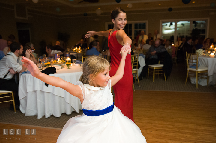 Flower girl dancing with her Mom. Riverhouse Pavilion wedding photos at Easton, Eastern Shore, Maryland by photographers of Leo Dj Photography. http://leodjphoto.com