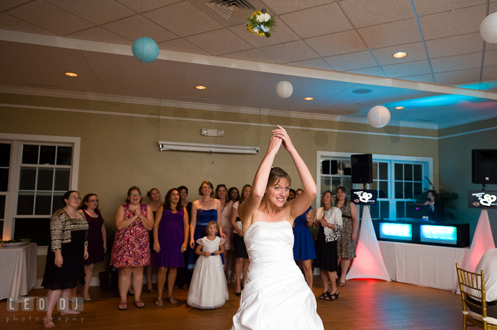Bride tossing the bouquet to the single ladies. Riverhouse Pavilion wedding photos at Easton, Eastern Shore, Maryland by photographers of Leo Dj Photography. http://leodjphoto.com