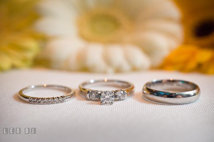Close up shot of the engagement ring, wedding ring and wedding band. Riverhouse Pavilion wedding photos at Easton, Eastern Shore, Maryland by photographers of Leo Dj Photography. http://leodjphoto.com