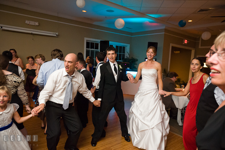 Bride and Groom dancing with their guests. Riverhouse Pavilion wedding photos at Easton, Eastern Shore, Maryland by photographers of Leo Dj Photography. http://leodjphoto.com