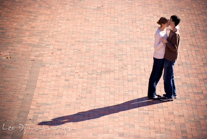 Engaged guy dancing with his fiancée. Pre-wedding engagement photo session at Washington College and Chestertown, Maryland, by wedding photographer Leo Dj Photography.