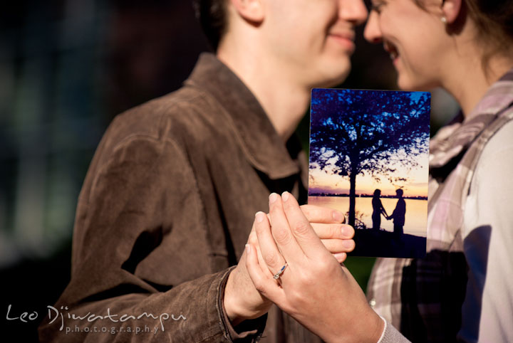 Engaged couple showing their silhouette sunset picture by a lake. Pre-wedding engagement photo session at Washington College and Chestertown, Maryland, by wedding photographer Leo Dj Photography.