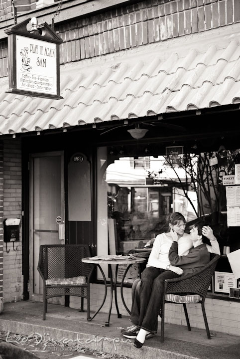 Engaged couple cuddling in front of Play It Again Sam coffee shop. Pre-wedding engagement photo session at Washington College and Chestertown, Maryland, by wedding photographer Leo Dj Photography.