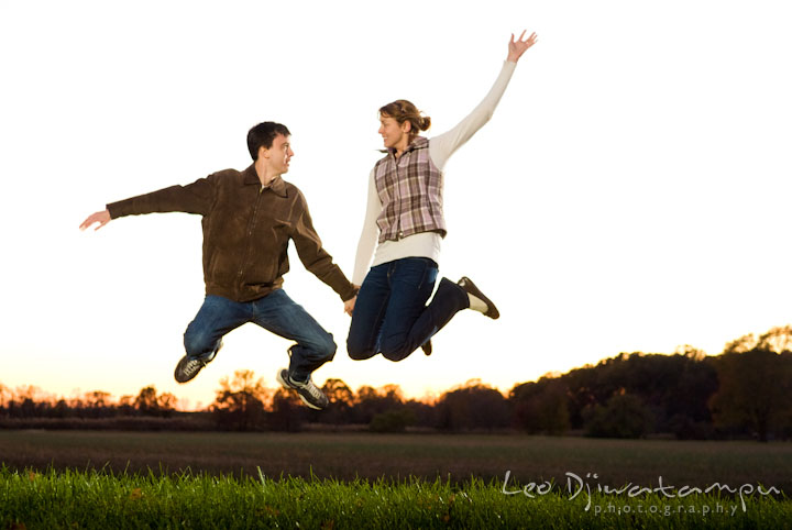 Engaged guy and girl jumping high. Pre-wedding engagement photo session at Washington College and Chestertown, Maryland, by wedding photographer Leo Dj Photography.