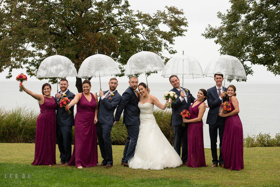 Chesapeake Bay Beach Club Bride and Groom with wedding party doing silly and fun pose photo by Leo Dj Photography.