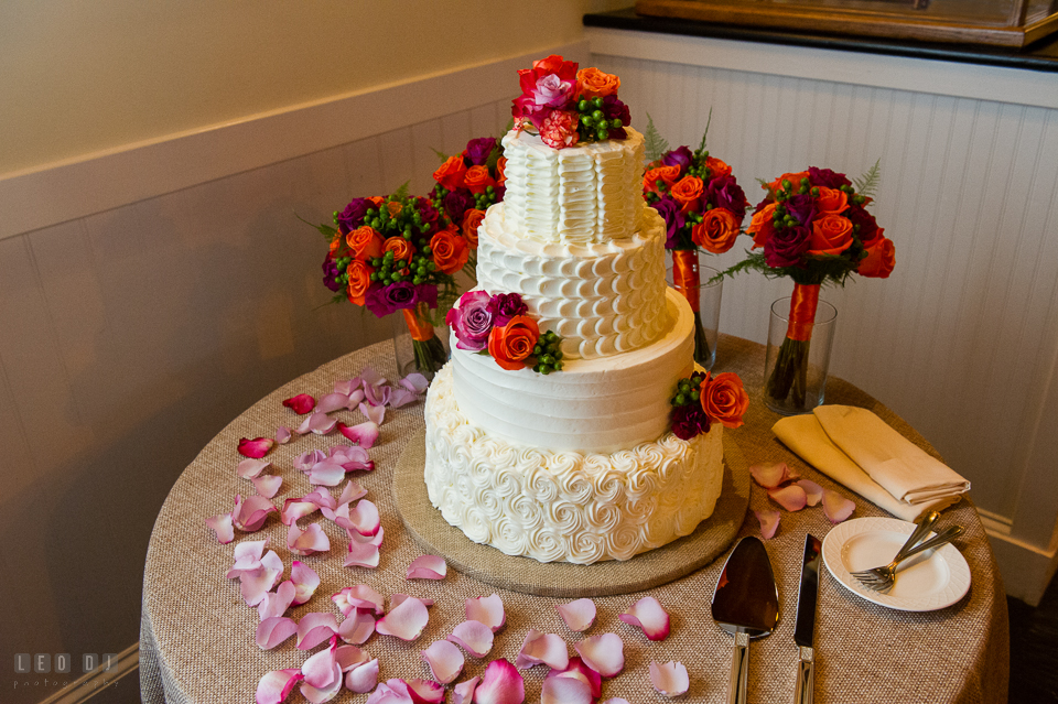 Chesapeake Bay Beach Club four-tiered wedding cake by Sugar Bakers photo by Leo Dj Photography.