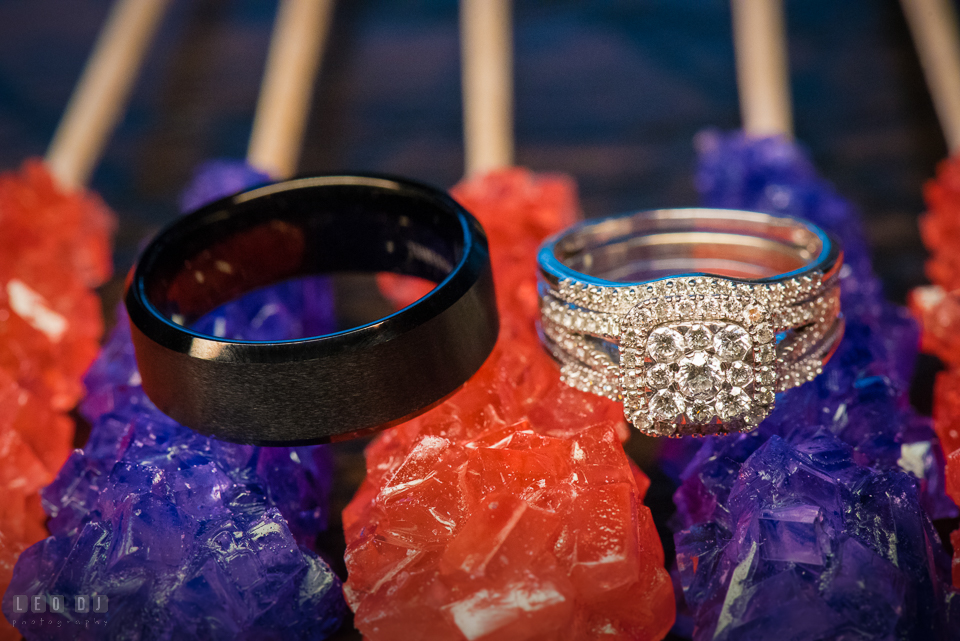 Chesapeake Bay Beach Club Bride and Groom wedding band and engagement ring on candies photo by Leo Dj Photography.