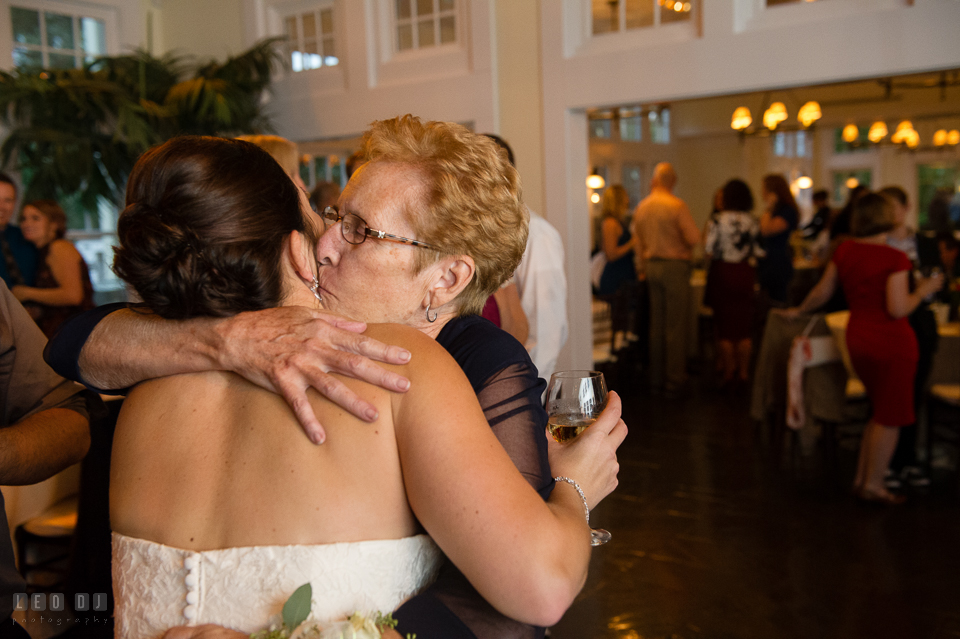 Chesapeake Bay Beach Club grandmother hugged and kissed Bride photo by Leo Dj Photography.