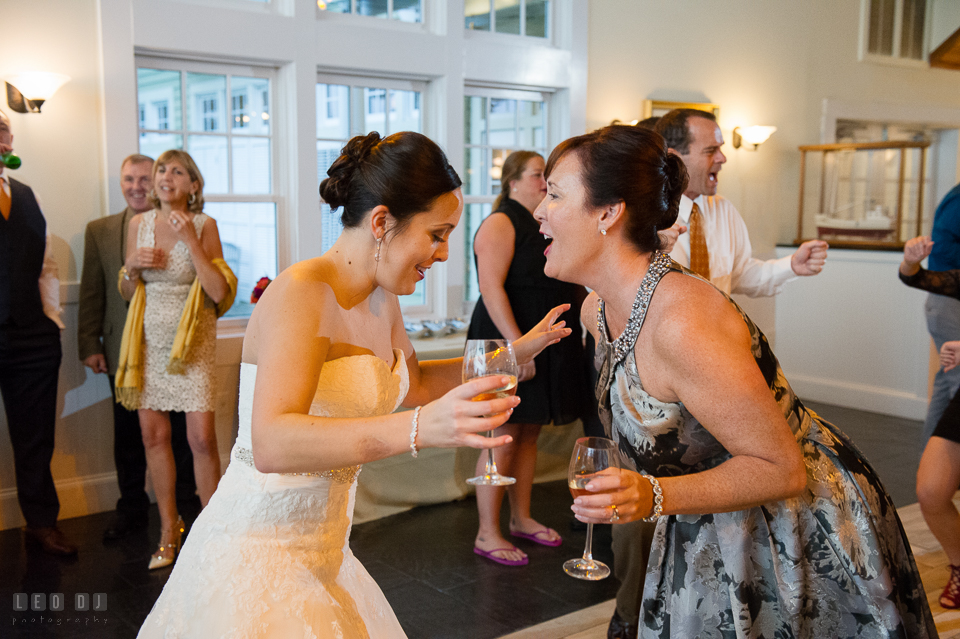 Chesapeake Bay Beach Club Mother singing and dancing with Bride photo by Leo Dj Photography.