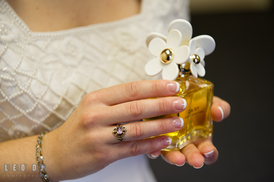 Bride holding bottle of perfume, Daisy by Marc Jacobs. Fisherman's Inn, Safe Harbor Church, Kent Island, Eastern Shore Maryland, wedding reception and ceremony photo, by wedding photographers of Leo Dj Photography. http://leodjphoto.com