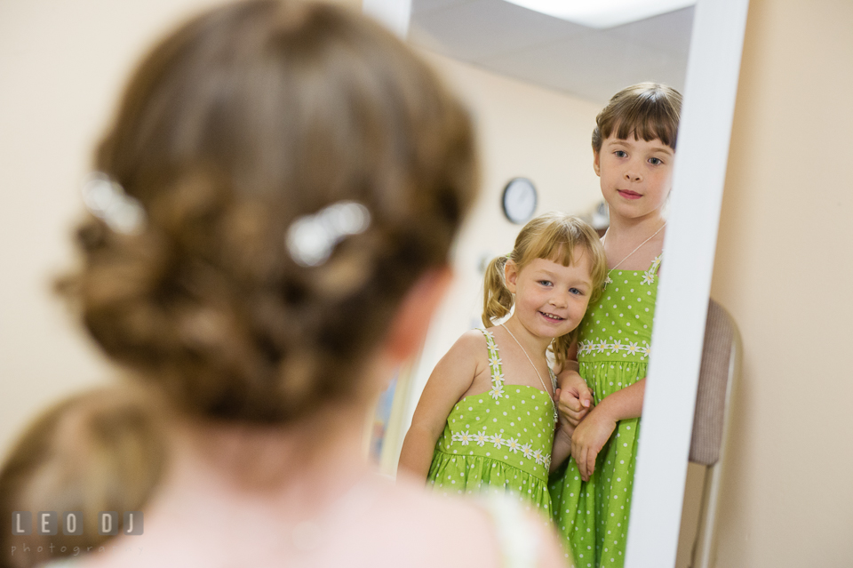 Flower girls looking at the mirror. Fisherman's Inn, Safe Harbor Church, Kent Island, Eastern Shore Maryland, wedding reception and ceremony photo, by wedding photographers of Leo Dj Photography. http://leodjphoto.com