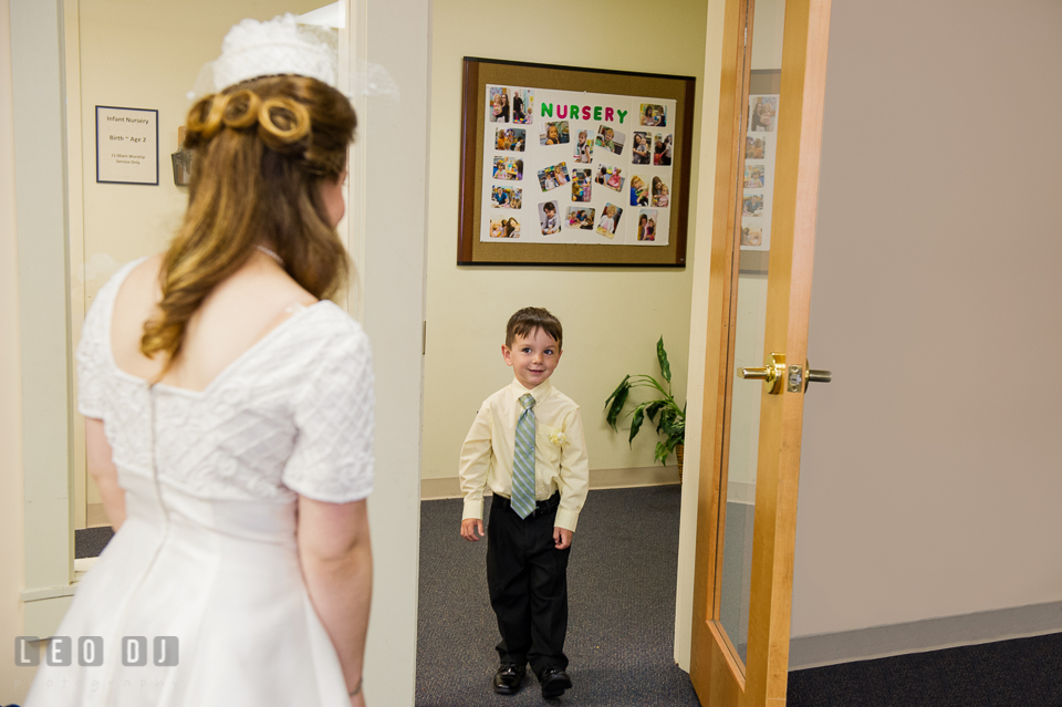 Bride meeting ring bearer boy. Fisherman's Inn, Safe Harbor Church, Kent Island, Eastern Shore Maryland, wedding reception and ceremony photo, by wedding photographers of Leo Dj Photography. http://leodjphoto.com