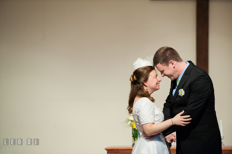 Bride and Groom smiling and hugging during ceremony. Fisherman's Inn, Safe Harbor Church, Kent Island, Eastern Shore Maryland, wedding reception and ceremony photo, by wedding photographers of Leo Dj Photography. http://leodjphoto.com