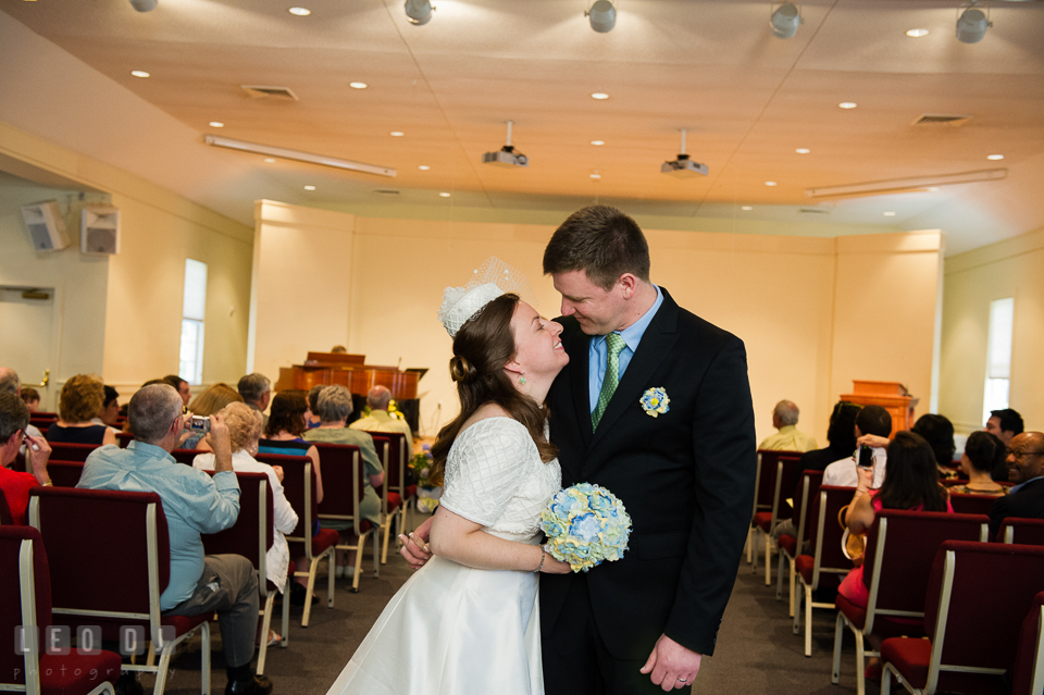 Bride and Groom almost kissed during recessional. Fisherman's Inn, Safe Harbor Church, Kent Island, Eastern Shore Maryland, wedding reception and ceremony photo, by wedding photographers of Leo Dj Photography. http://leodjphoto.com