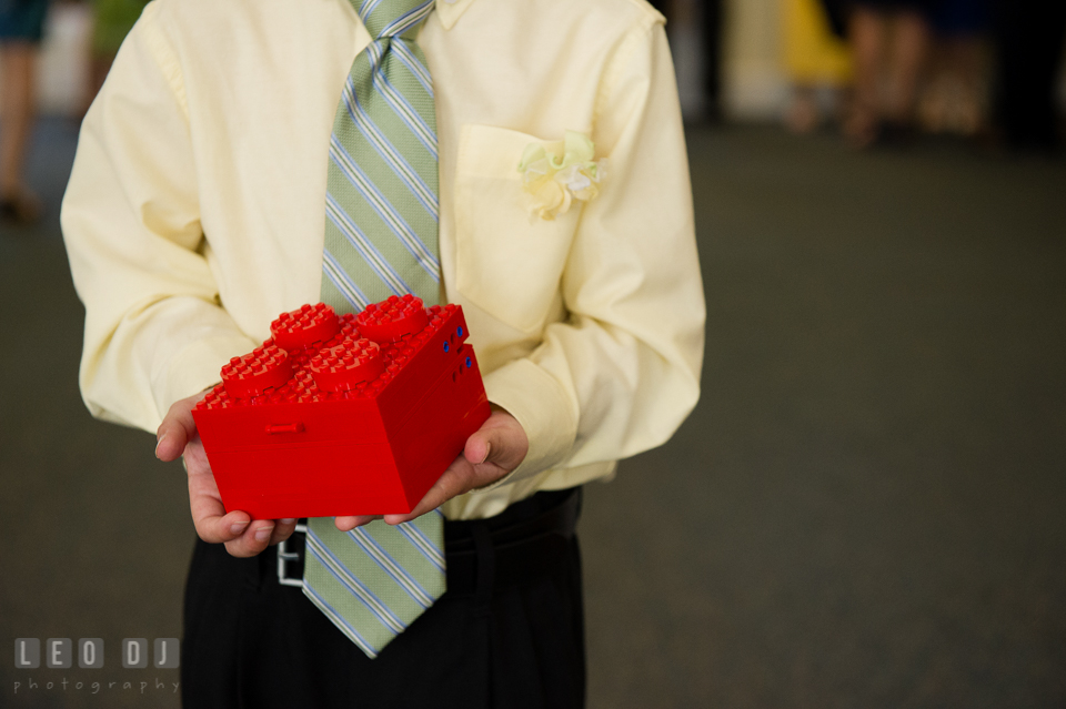 Ring bearer boy holding ring box made out of LEGO. Fisherman's Inn, Safe Harbor Church, Kent Island, Eastern Shore Maryland, wedding reception and ceremony photo, by wedding photographers of Leo Dj Photography. http://leodjphoto.com