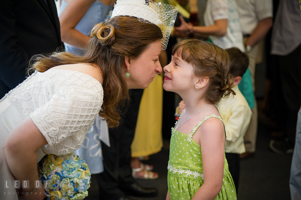 Bride nose cuddle with her niece, the flower girl . Fisherman's Inn, Safe Harbor Church, Kent Island, Eastern Shore Maryland, wedding reception and ceremony photo, by wedding photographers of Leo Dj Photography. http://leodjphoto.com