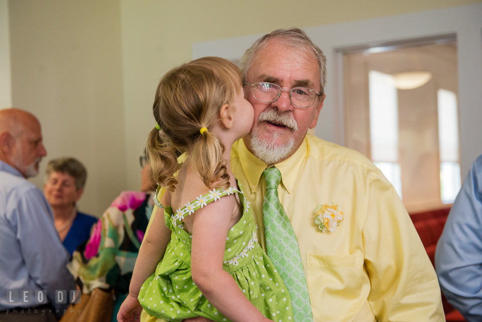 Flower girl kissing her Grandfather, the Father of the Groom. Fisherman's Inn, Safe Harbor Church, Kent Island, Eastern Shore Maryland, wedding reception and ceremony photo, by wedding photographers of Leo Dj Photography. http://leodjphoto.com