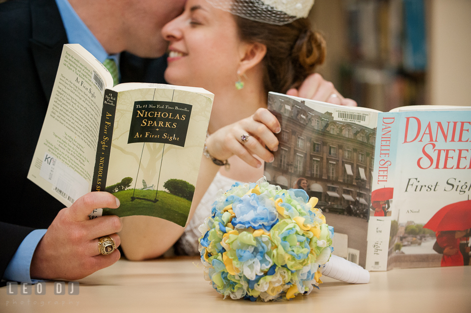 Groom kissed Bride while reading books together in the library. Fisherman's Inn, Safe Harbor Church, Kent Island, Eastern Shore Maryland, wedding reception and ceremony photo, by wedding photographers of Leo Dj Photography. http://leodjphoto.com